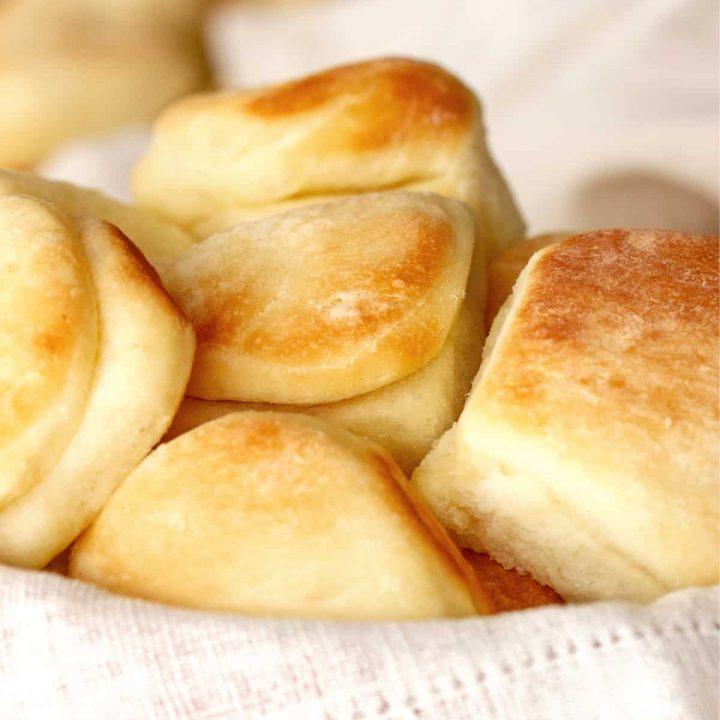 Dinner rolls mounded on a napkin