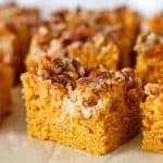 Close up of pumpkin cake squares with pecans