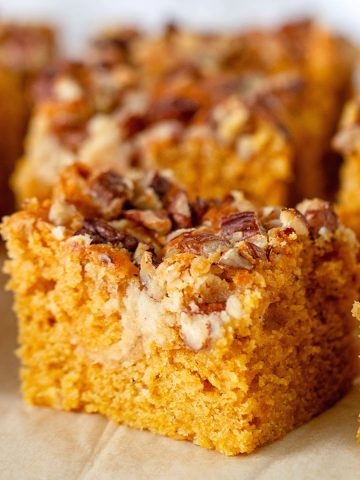 Close up of pumpkin cake squares with pecans