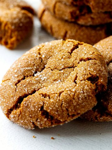 Close up of gingersnap crackled cookies on white surface