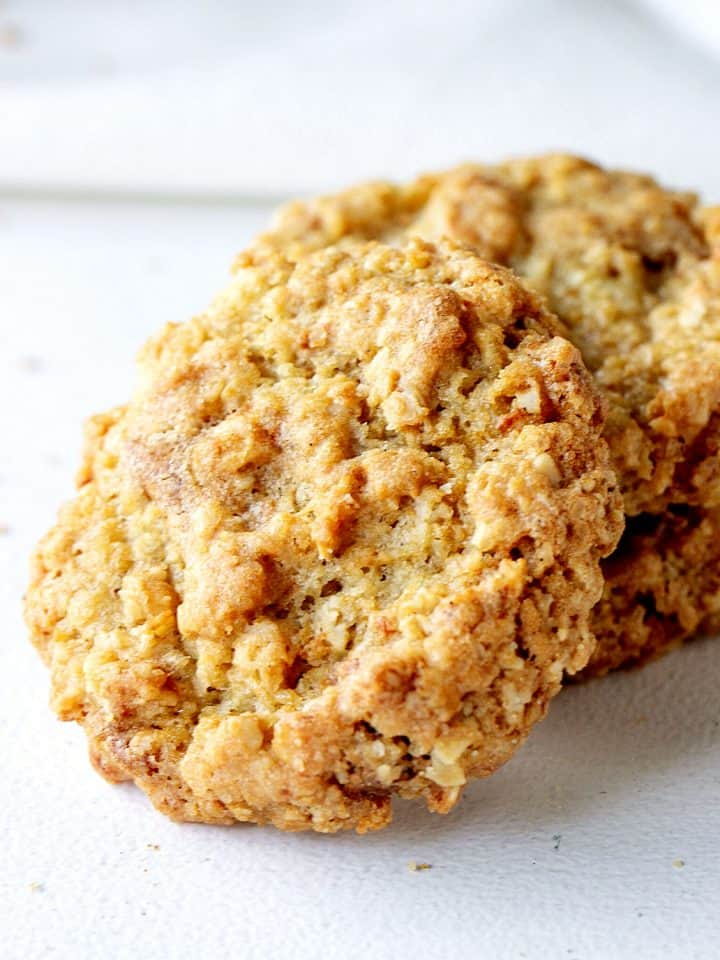 Close up of oatmeal cookie on white surface