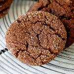 Close up of crackled ginger molasses cookie on wire rack