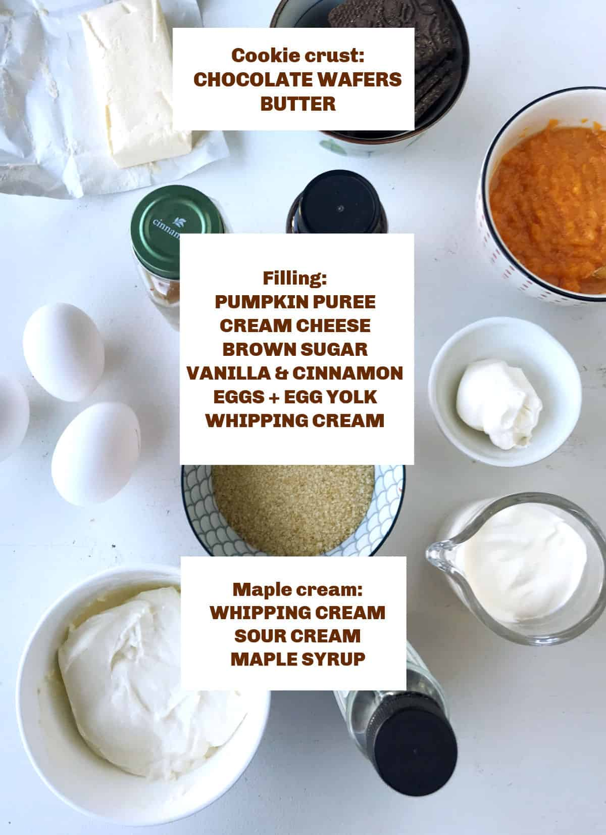 Ingredients for pumpkin cream cheesecake in bowls and containers on a white surface