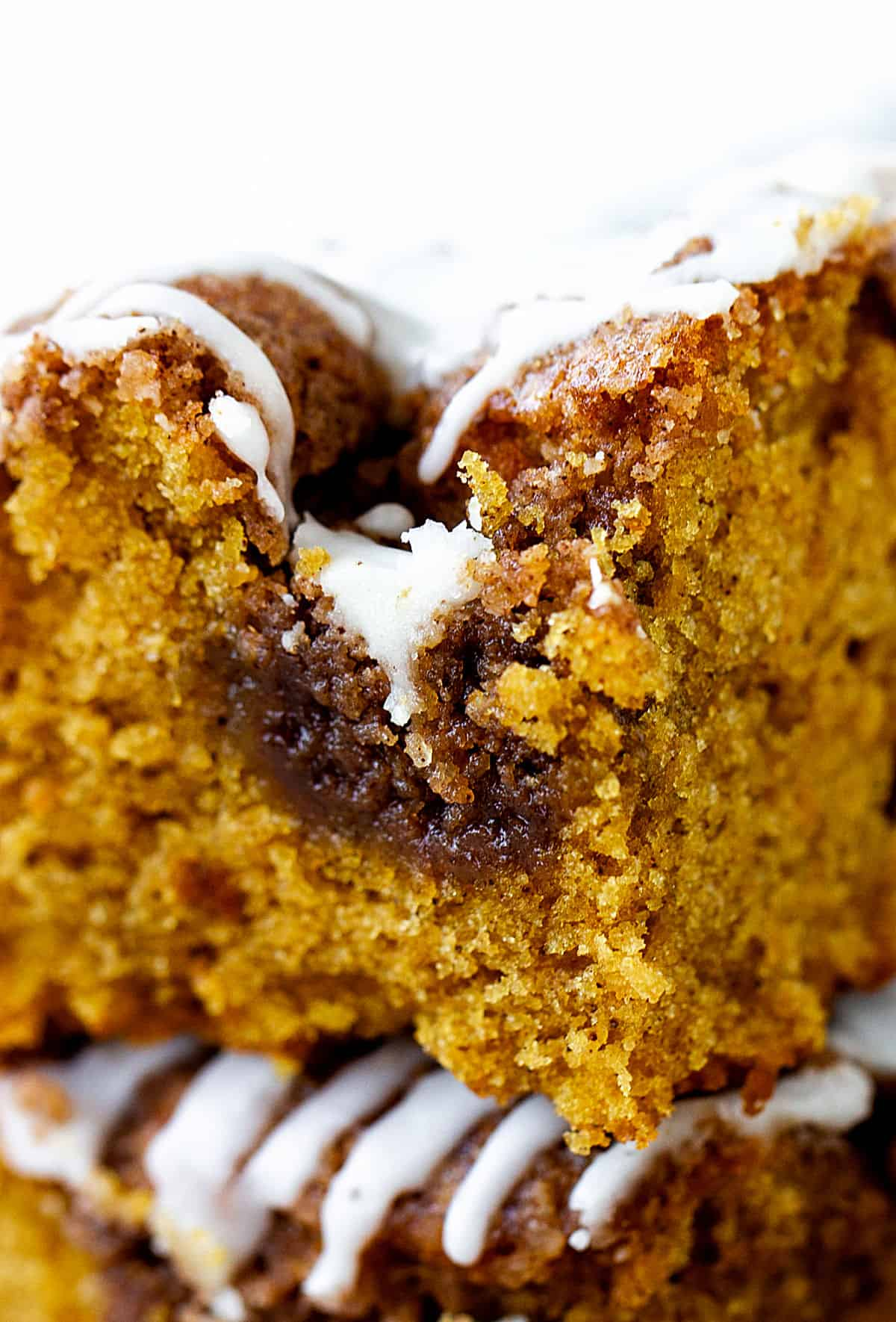 Zooming in to crumble puddle and glaze of pumpkin cake square