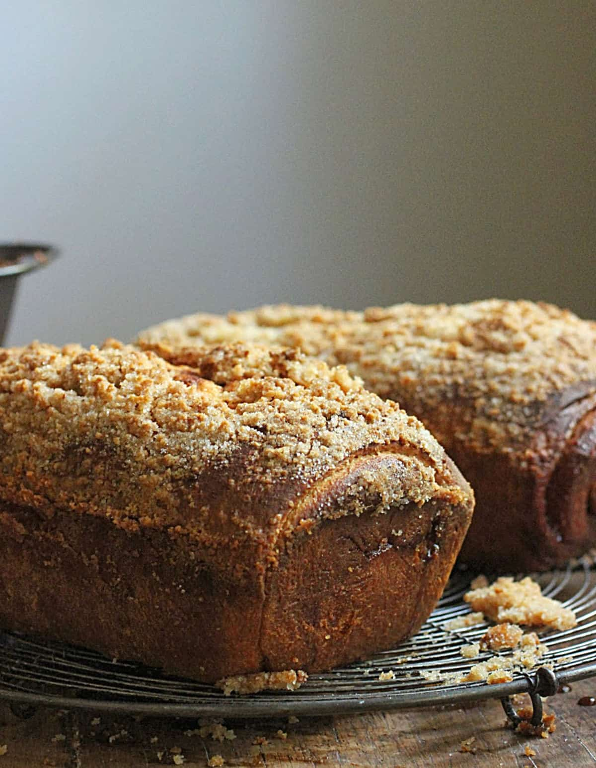 Baked loaves of swirl bread with crumble on a wooden table