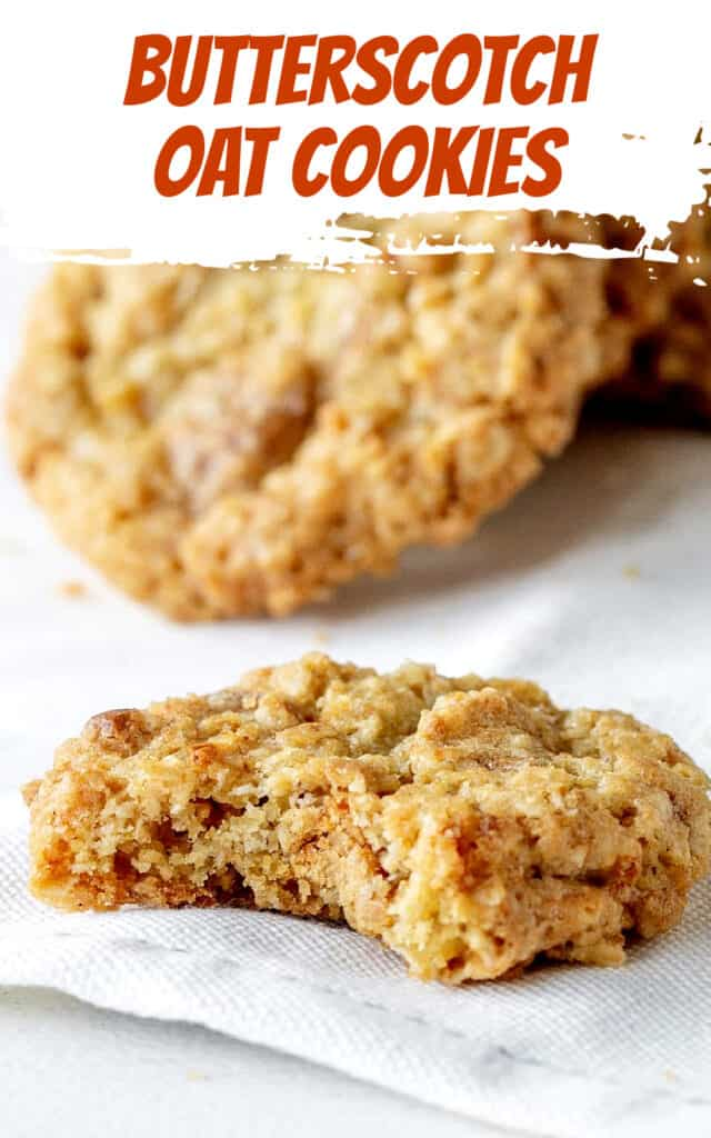 Bitten oatmeal cookie on white cloth, other cookie in background; white and orange text