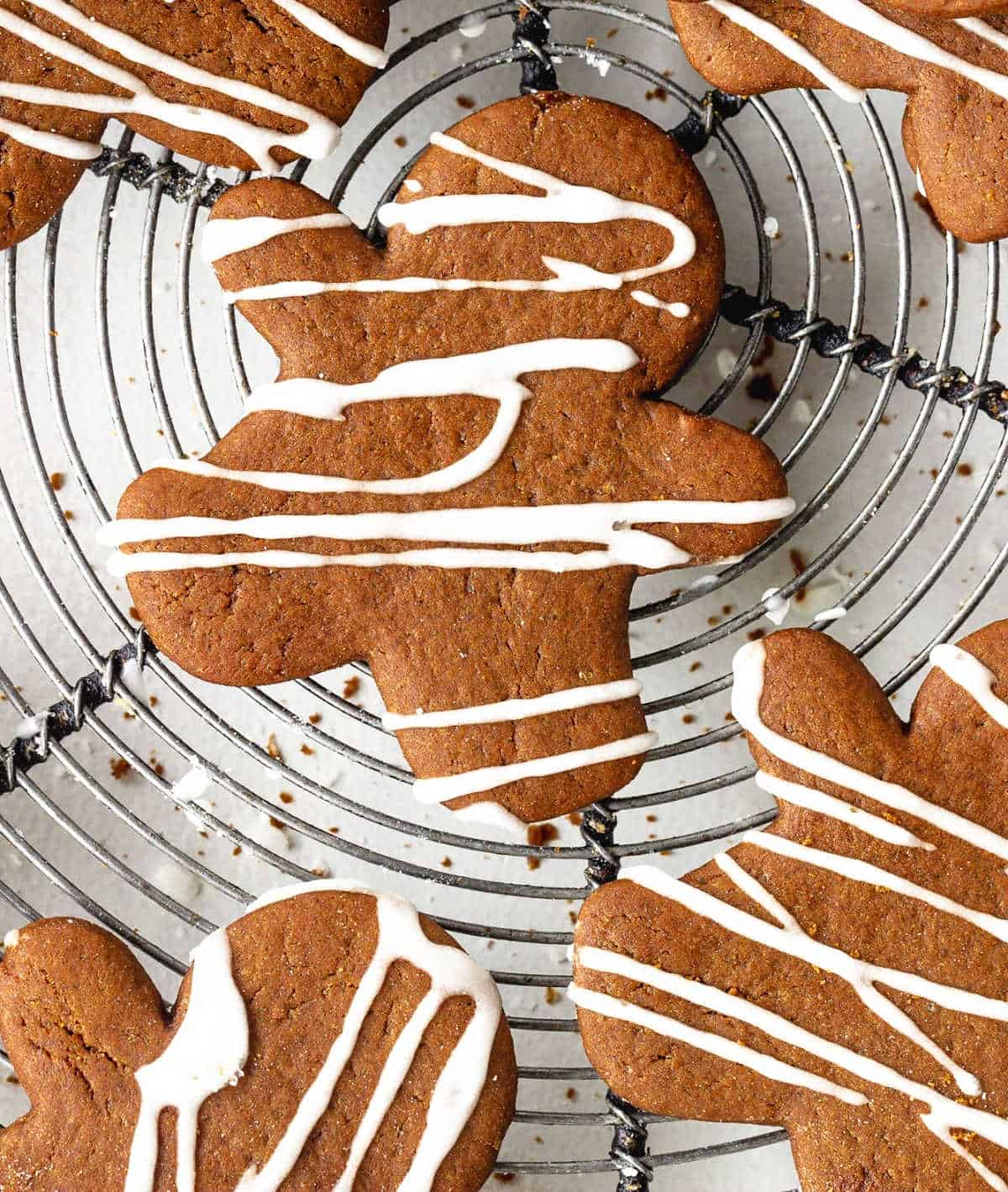 Close up aerial view of iced gingerbread people on a metal wire rack