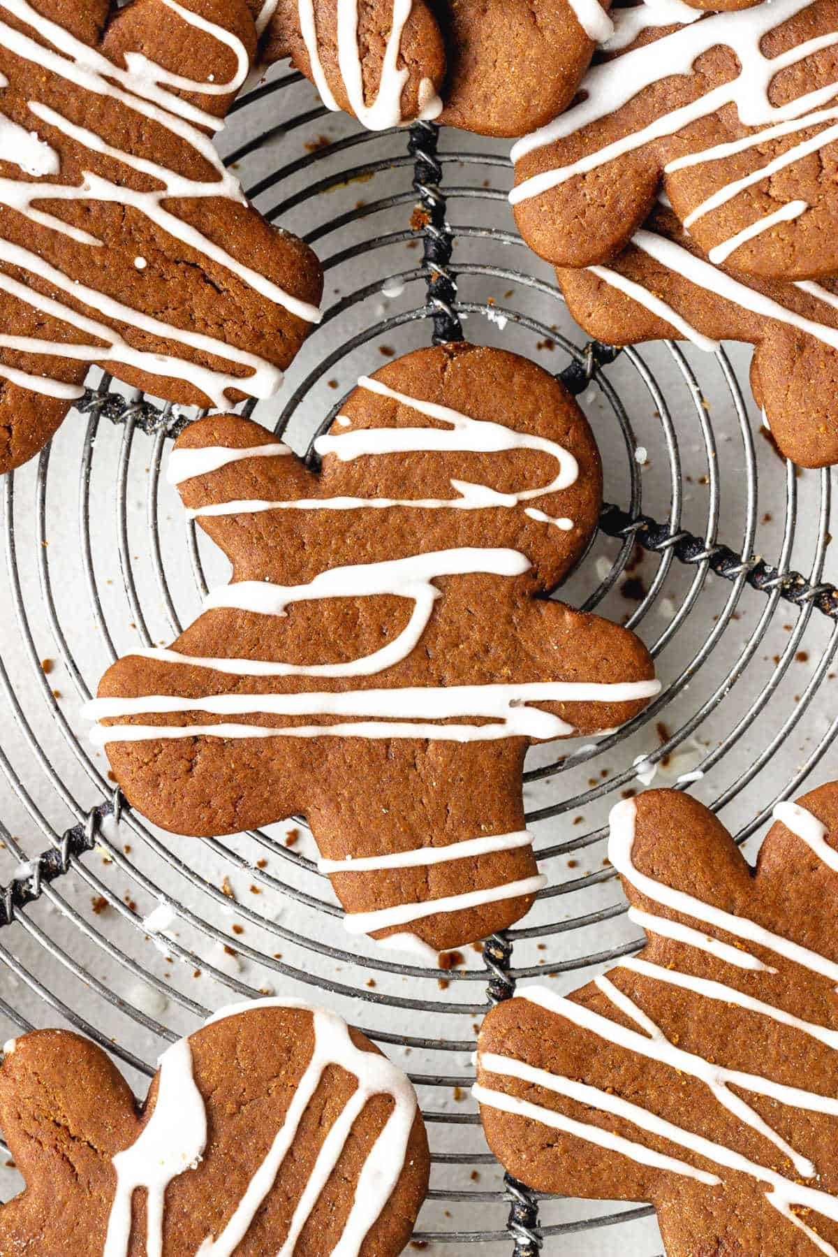 Top view of iced gingerbread cut out people on a wire rack