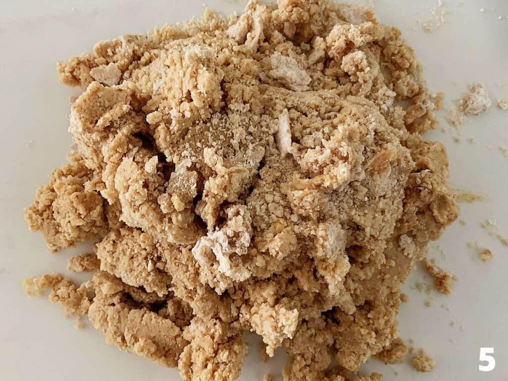 Shaggy mass of spice dough on a whitish surface