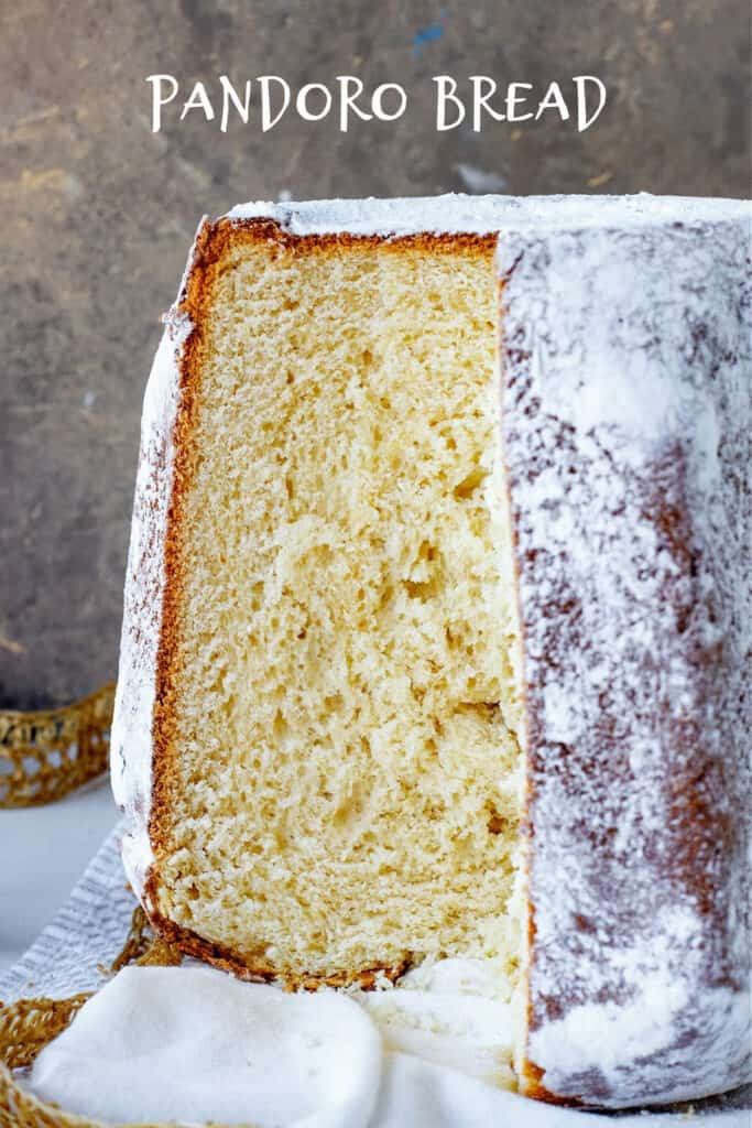 Pandoro bread with missing piece on golden grey background; white text