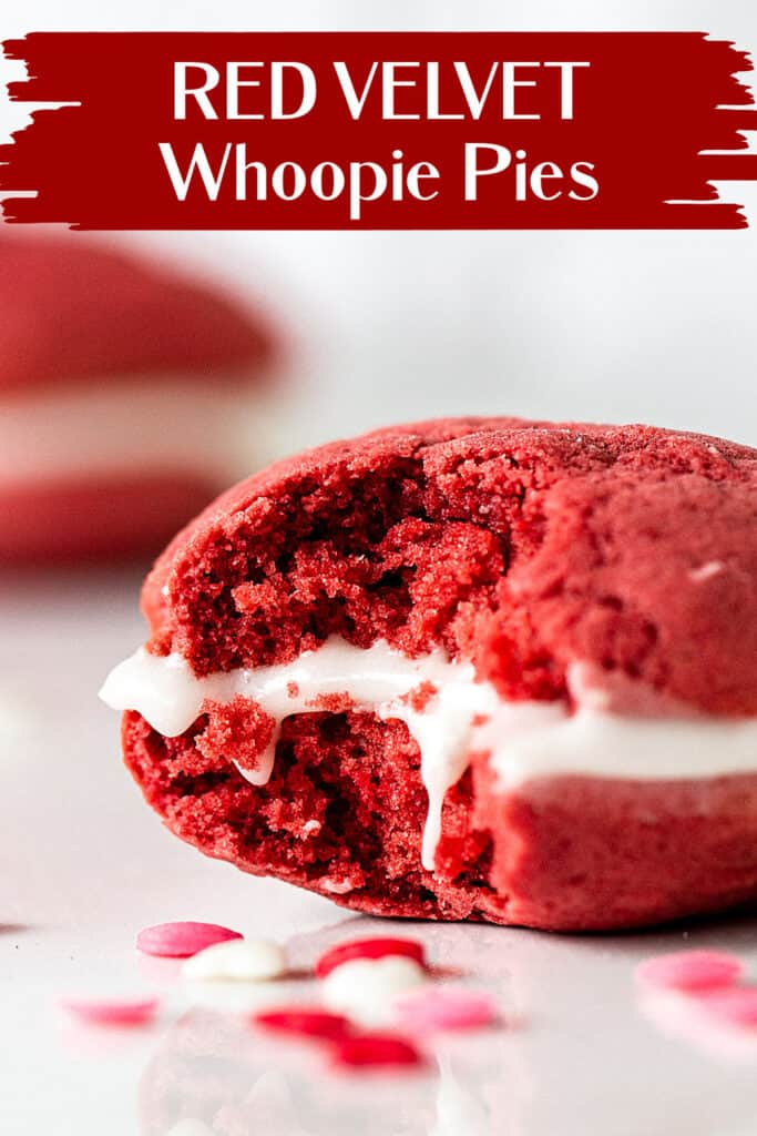 Close up of eaten red velvet whoopie pie on white marble, confetti around, red white text overlay