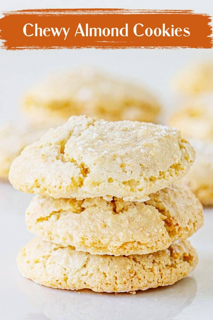 Three stacked almond cookies on white background; brown white text overlay
