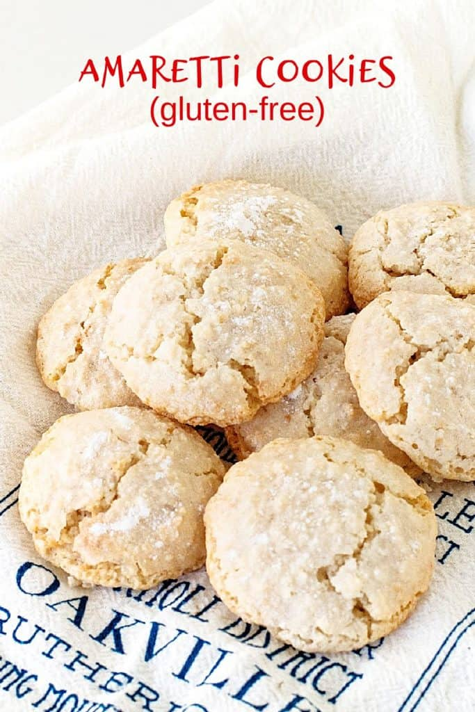 Several crackled almond cookies on white and blue kitchen towel; red text overlay