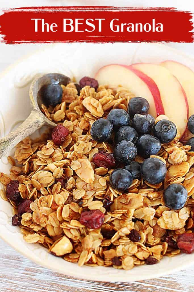 Close up of granola and fruit on white bowl; red text overlay