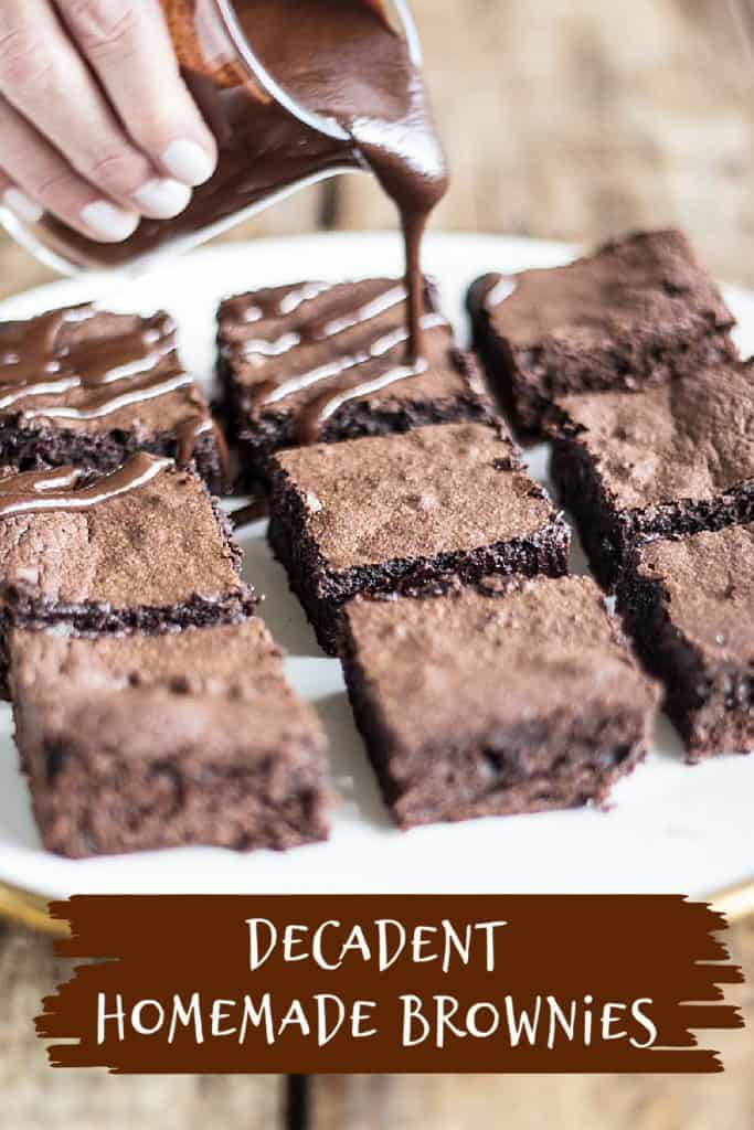 Pouring chocolate sauce on brownie squares on a white plate; brown white text overlay