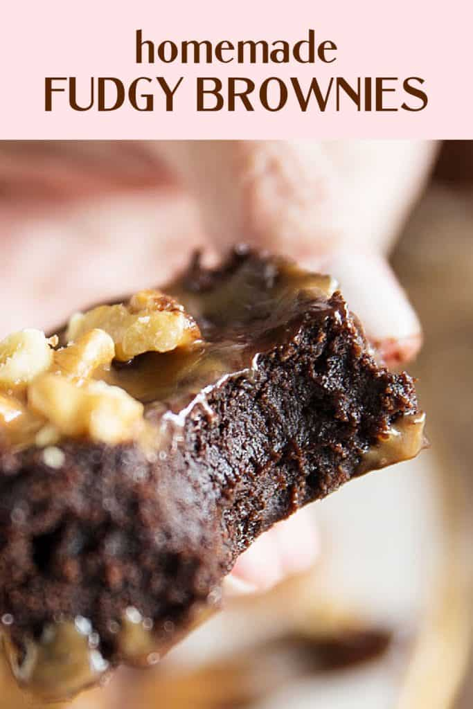 Close up of bitten fudgy brownie, pink brown text overlay