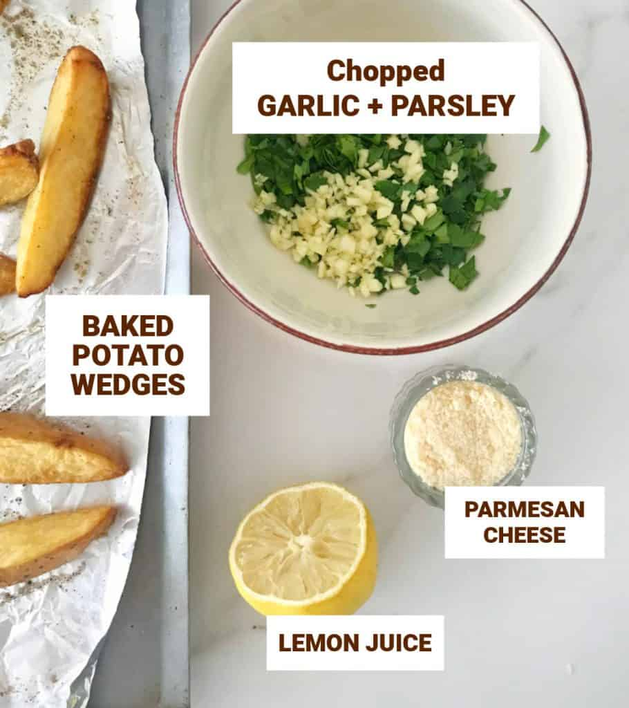 Chopped garlic and parsley, parmesan in bowls, half a lemon, potato wedges, white surface