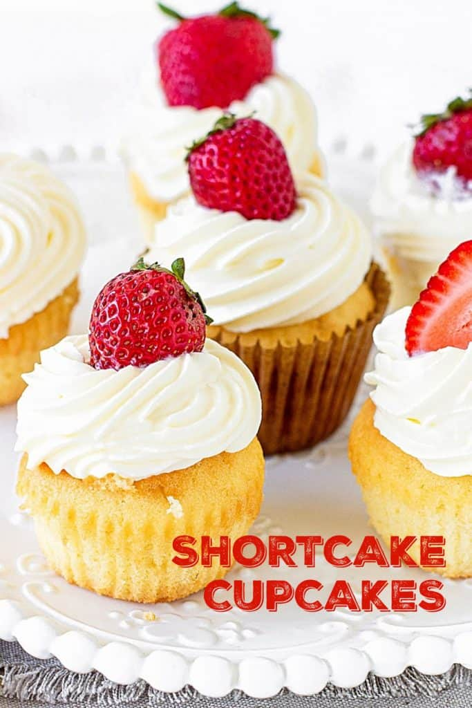 Several whole strawberry shortcake cupcakes on white plate; red text overlay