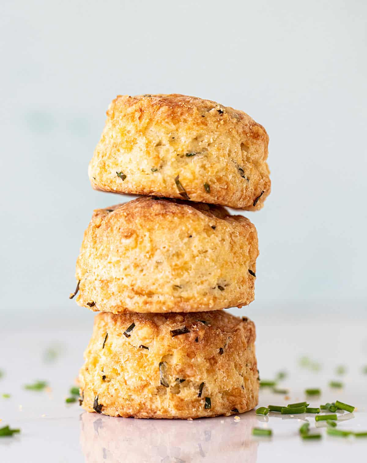 Stack of three scones on light colored surface and background
