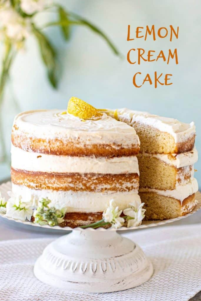 Layer lemon cake on cake stand with green background; brown text overlay