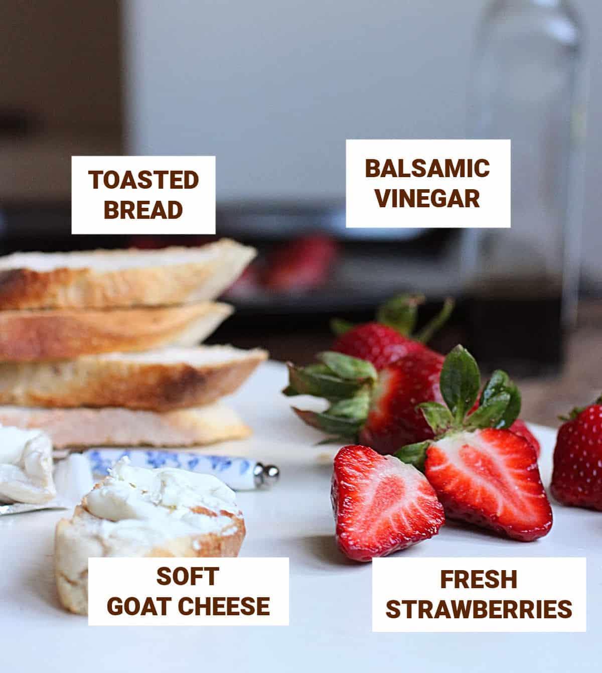 Strawberries, bread slices, vinegar bottle, cheese, knife on white table, text overlay