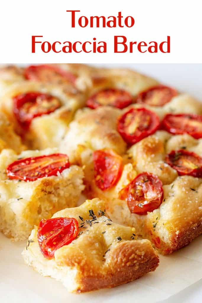 Close of tomato focaccia squares on white surface; red text overlay