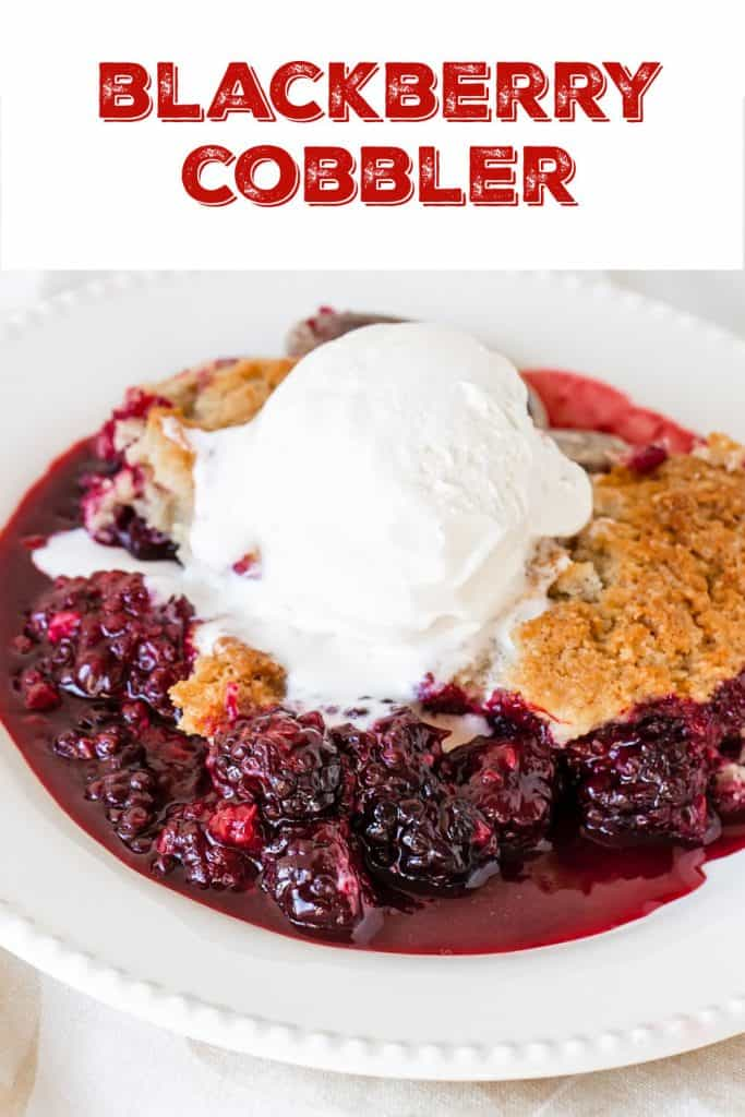 Serving of blackberry cobbler with ice cream on white plate; red text overlay
