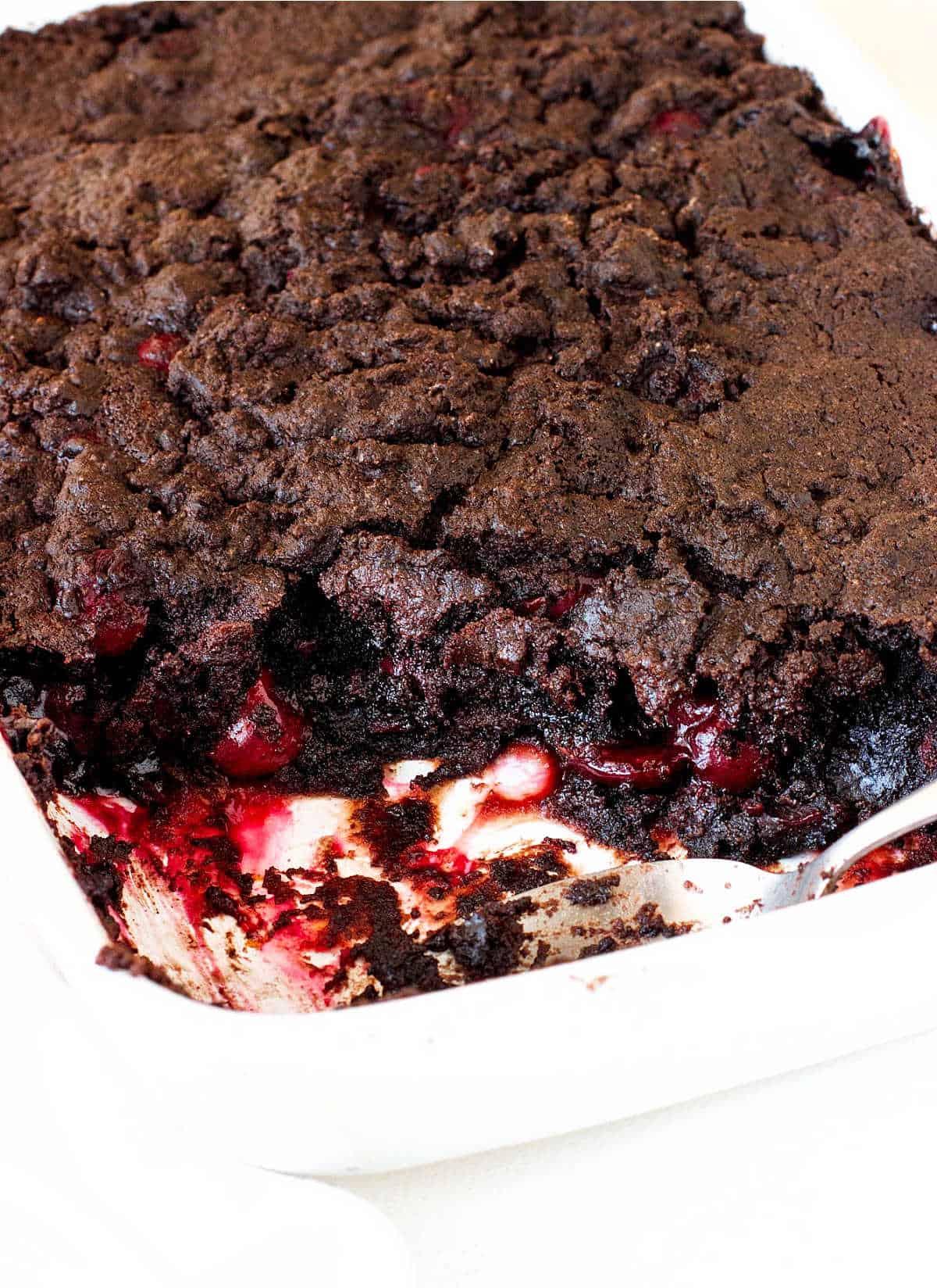 Chocolate cherry dump cake in a rectangular white ceramic dish