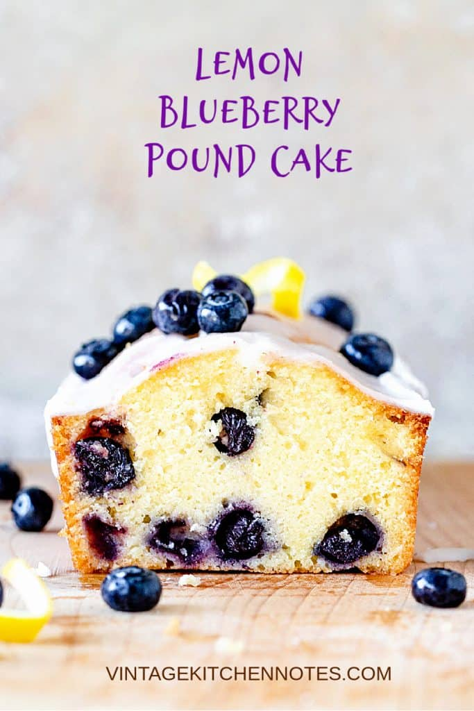 Cut pound cake with blueberries on wooden board and grey background with purple text overlay