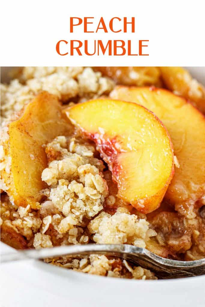 Close up of peach crumble serving with orange text overlay