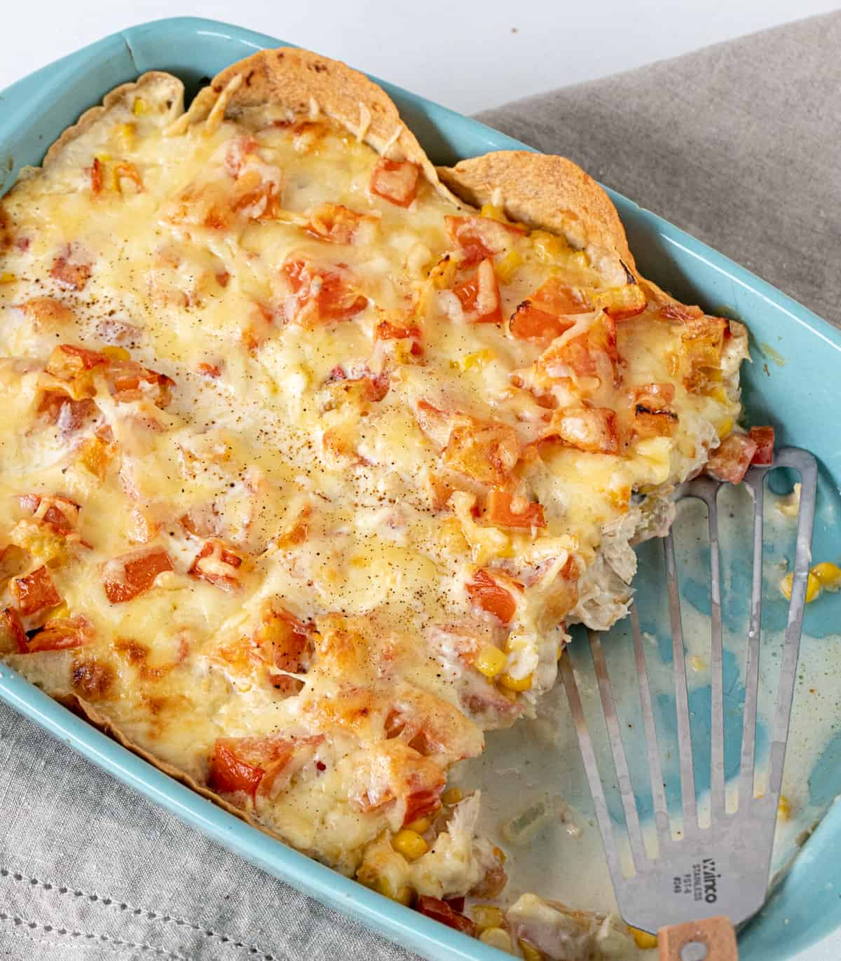 Top view of light blue dish with Mexican lasagna