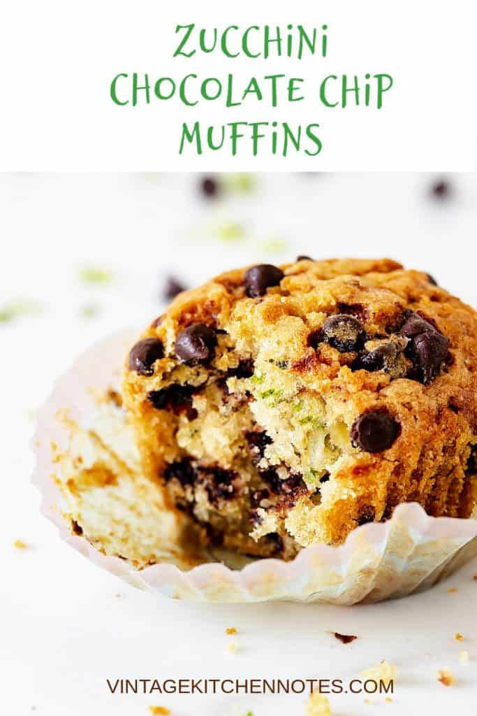 Zucchini chocolate chip muffin in paper liner and white background; green text overlay