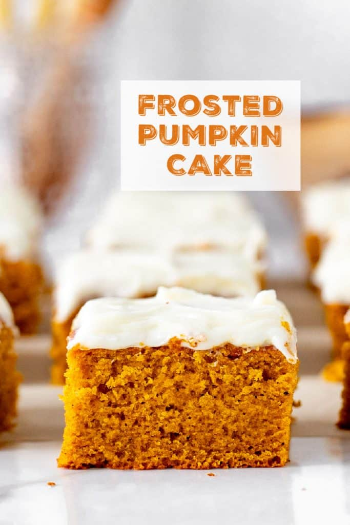 single slice of frosted pumpkin case on white marble, blurred cake in background, orange text overlay