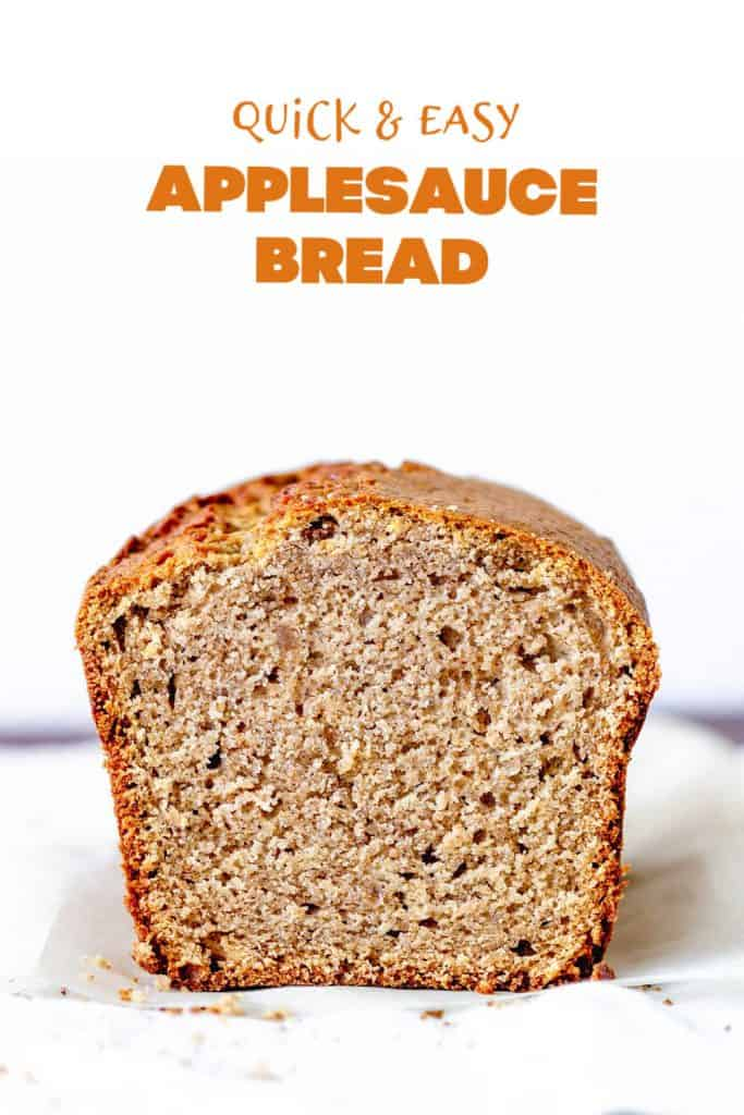 Front view of cut applesauce loaf, white surface and background, orange text overlay