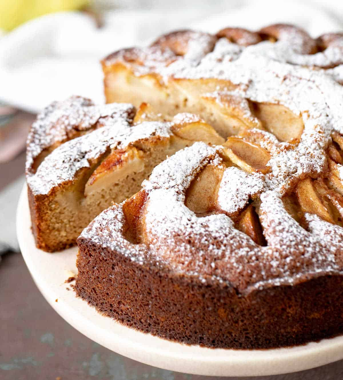 Close up of pear cake on pink cake stand