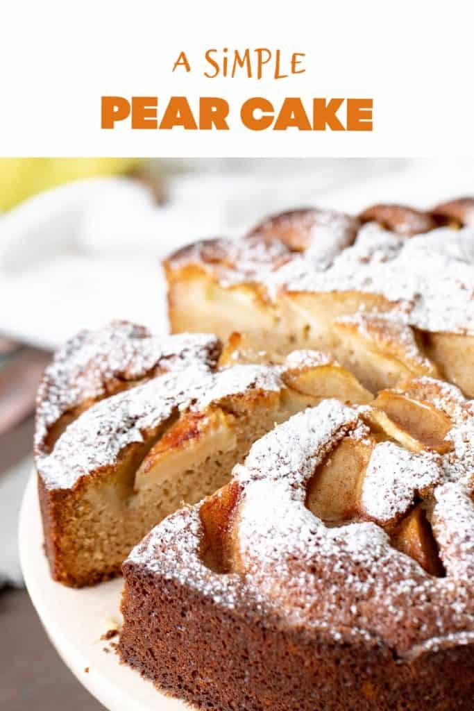 Whole pear cake with cut slice, orange text overlay